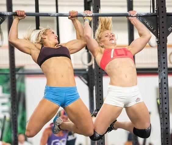 Brooke Ence and Annie Thorisdottir do synchronized butterfly pull-ups