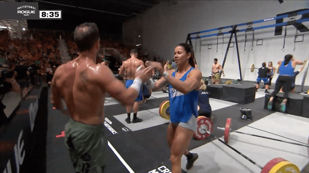 Chyna Cho and Rich Froning celebrate as the first two athletes to finish their half of the third team event at the Rogue Invitational.