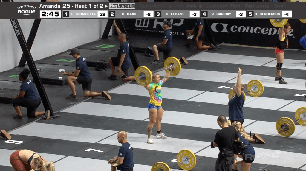 Brooke Haas in a tie dyed shirt works through her squat snatches.