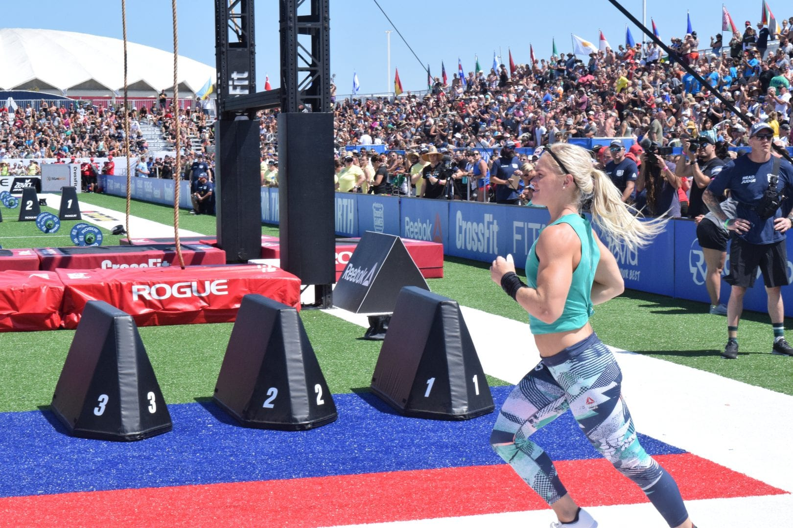 Katrin Davidsdottir jogs onto the field on the first day of the 2019 CrossFit Games