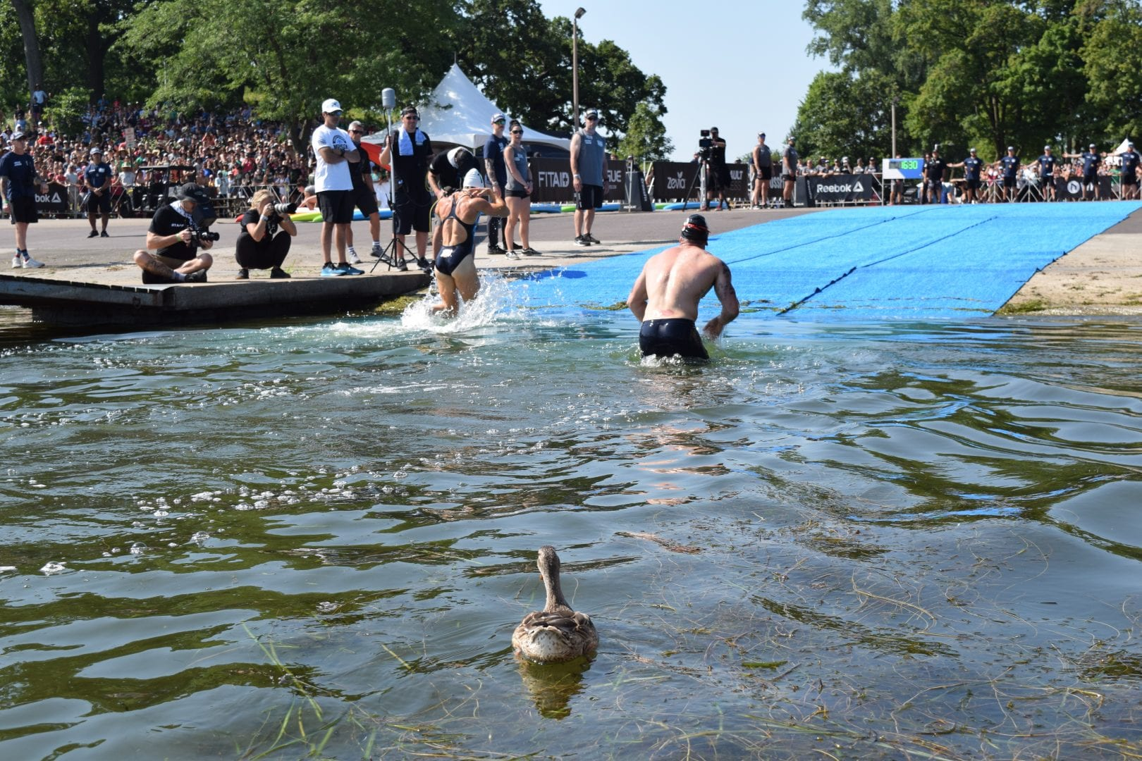 Tia-Clair Toomey is the first out of the water in the Swim Paddle event at the 2019 CrossFit Games