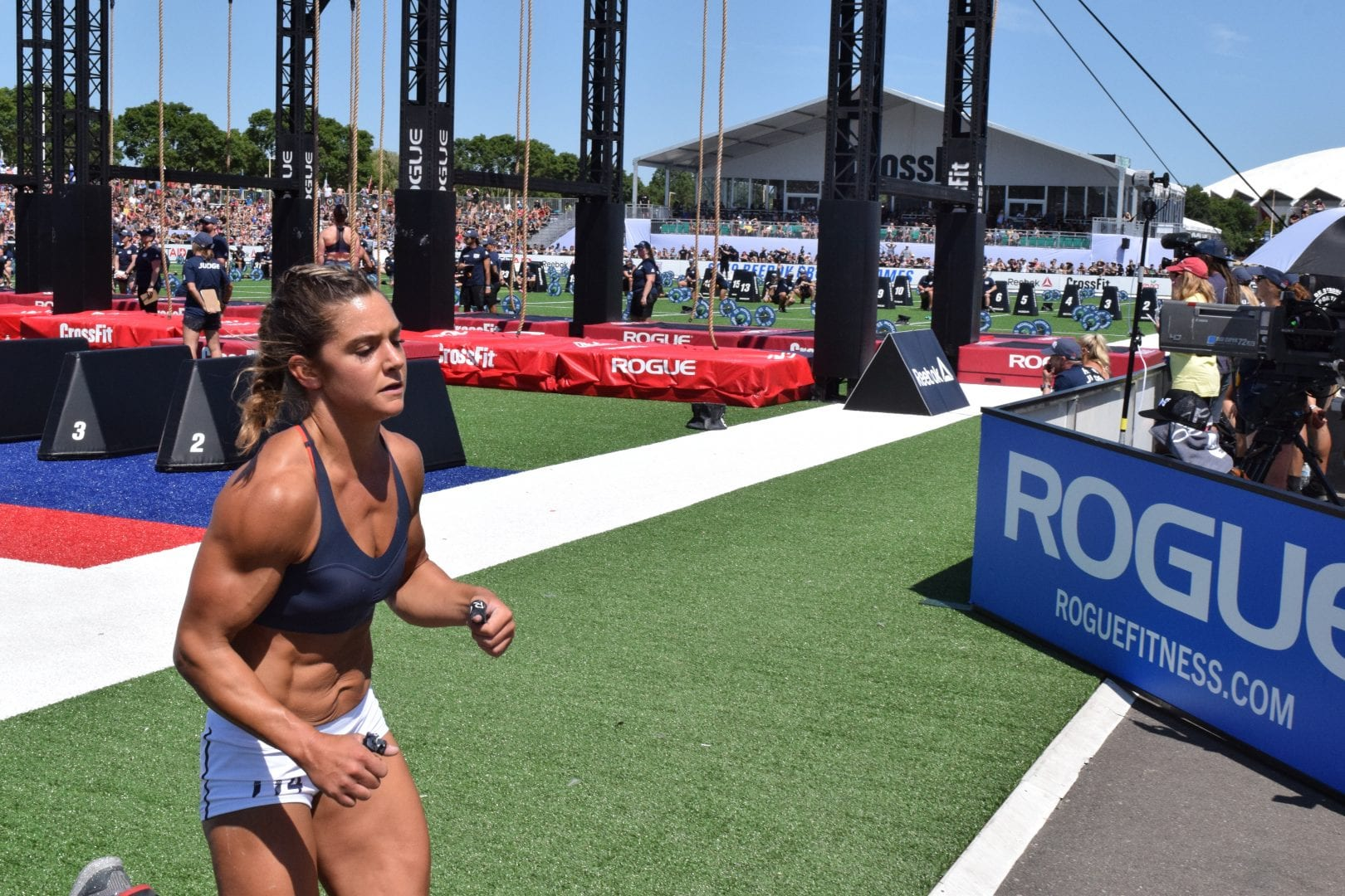 Carrie Beamer begins a round of running between legless rope climbs at the 2019 CrossFit Games