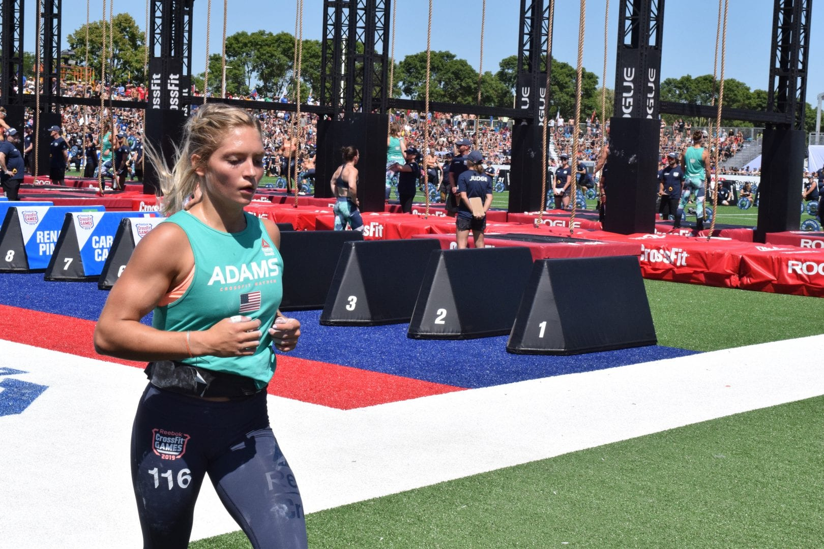 Haley Adams runs between sets of legless rope climbs at the 2019 CrossFit Games