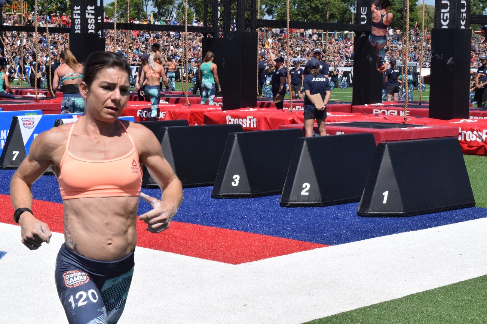 Cheryl Nasso completes a lap between rounds of legless rope climbs at the 2019 CrossFit Games
