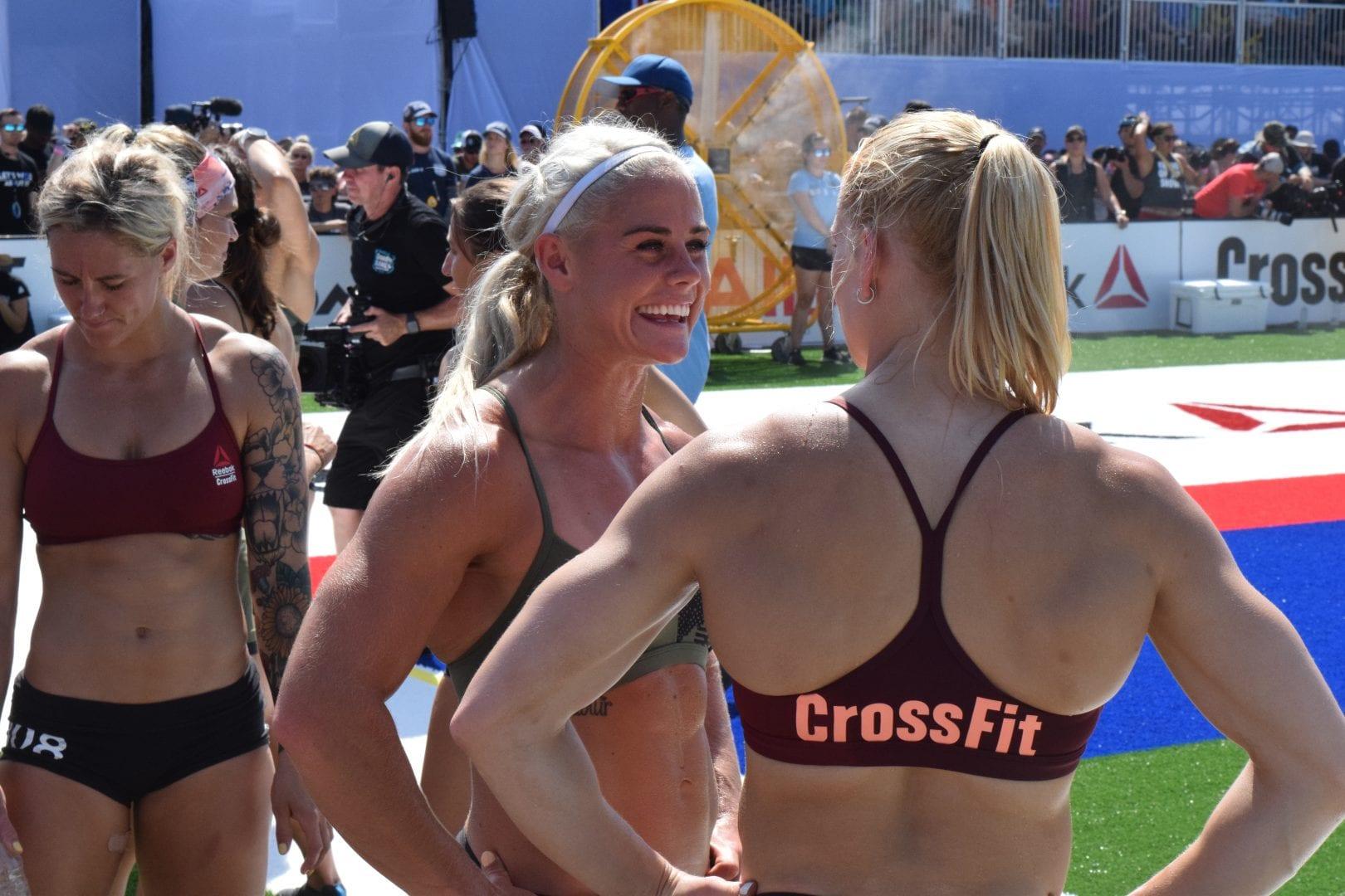 Sara Sigmundsdottir and Annie Thorisdottir talk on the sideline of the Sprint event at the 2019 CrossFit Games.