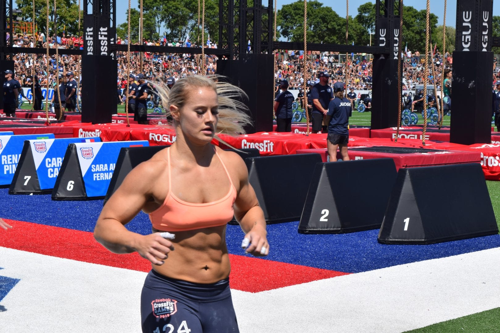 Dani Speegle takes a lap between rounds of legless rope climbs at the 2019 CrossFit Games