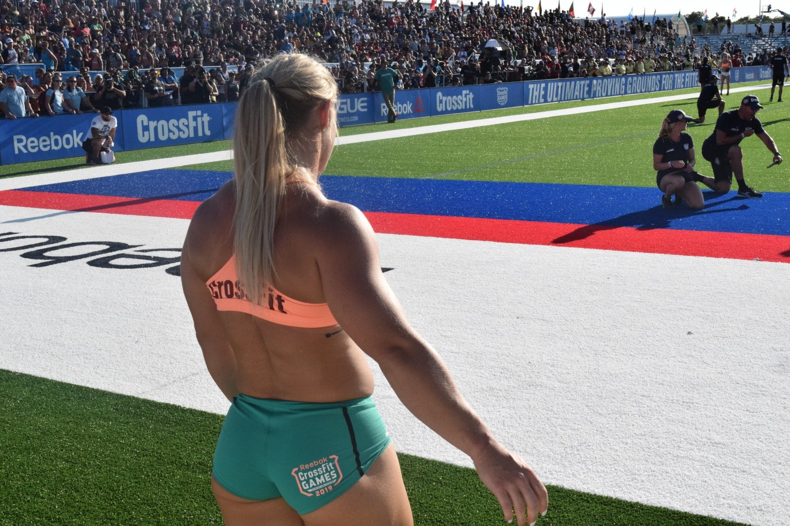 Dani Speegle watches later finishers from the finish line of an event at the 2019 CrossFit Games