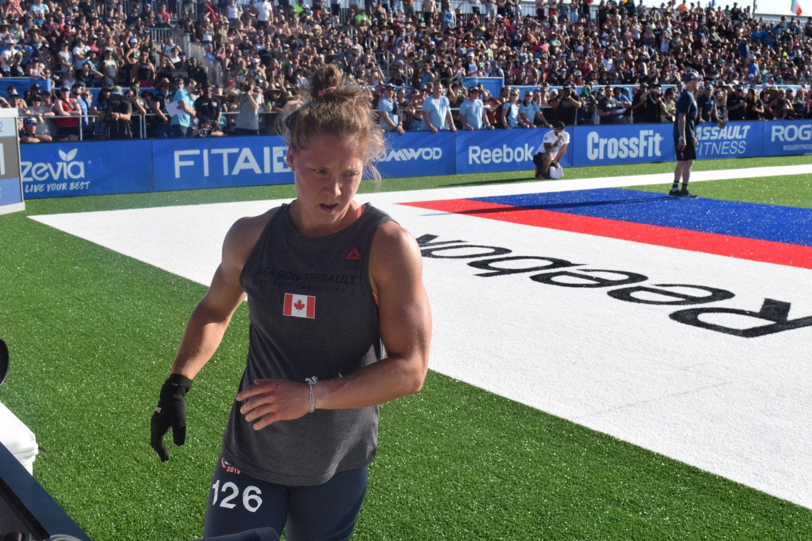 Carol-Ann Reason-Thibault crosses the finish line of an event at the 2019 CrossFit Games