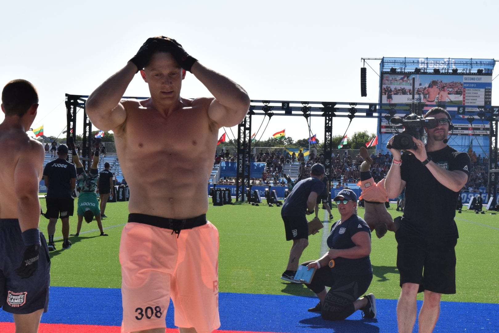 Brent Fikowski crosses the finish line of the second event at the 2019 CrossFit Games