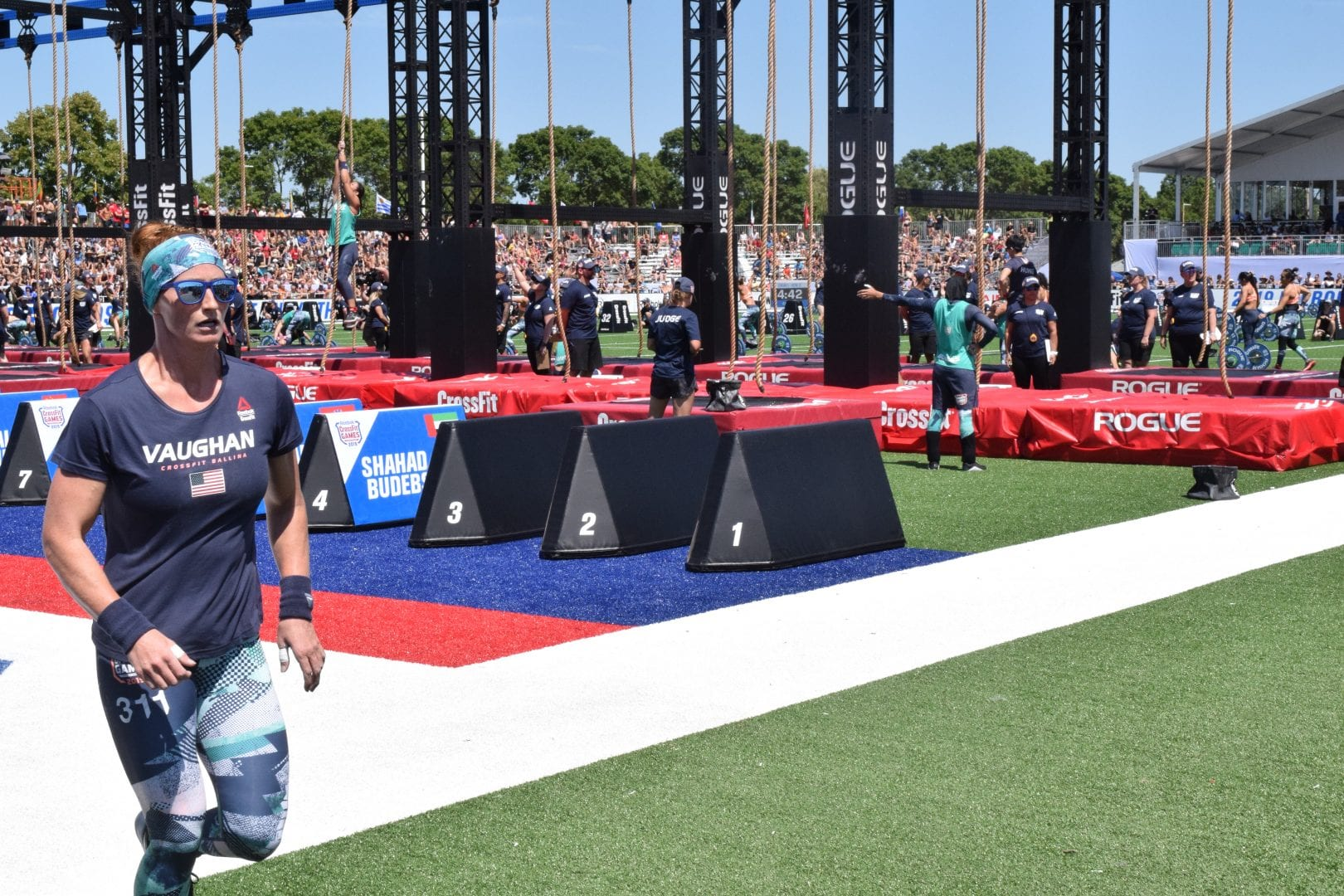 Lindsay Vaughan starts a lap between rounds of legless rope climbs at the 2019 CrossFit Games