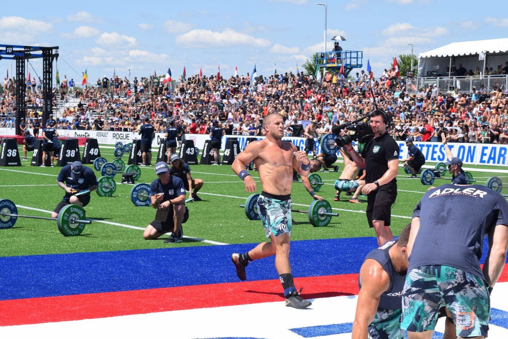 Jacob Heppner crosses the finish line of an event at the 2019 CrossFit Games.