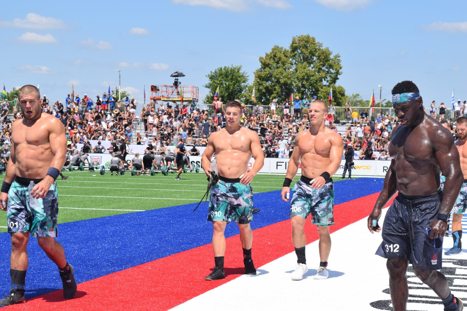 Jacob Heppner and Scott Panchik walk off the field after completing an event at the 2019 CrossFit Games.