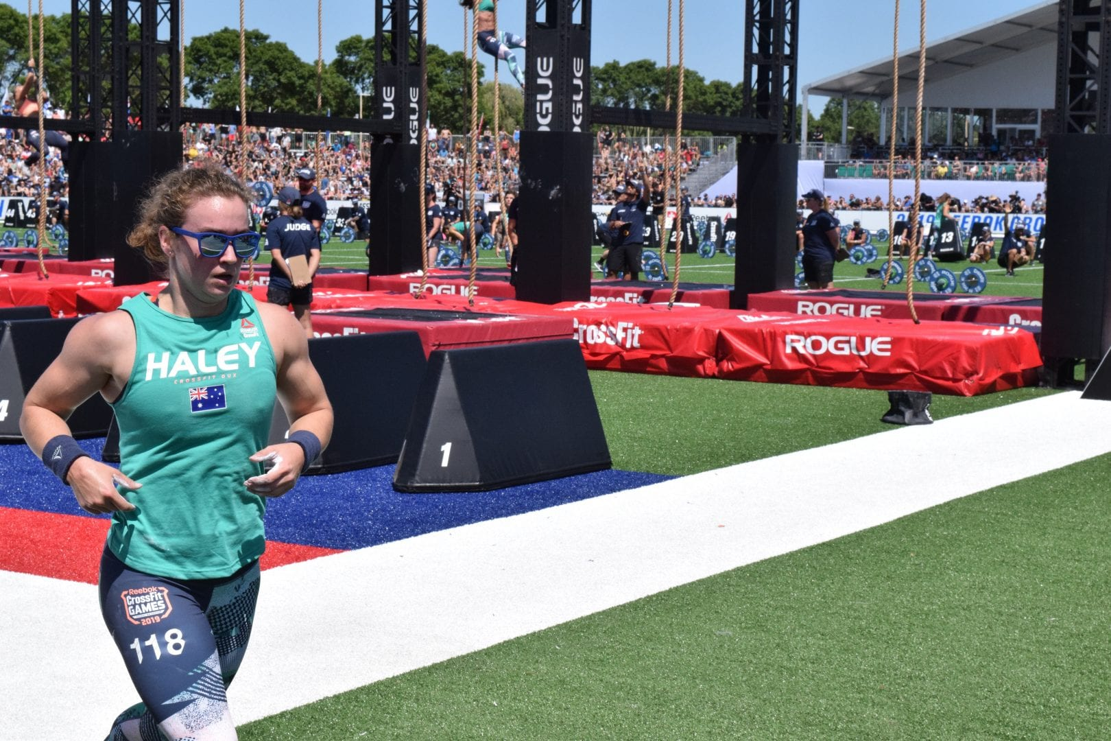 Courtney Haley completes a lap between rounds of legless rope climbs at the 2019 CrossFit Games.